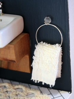 Towel rail made from a wine charm and bead