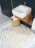 Crochet doily mat and second hand bin